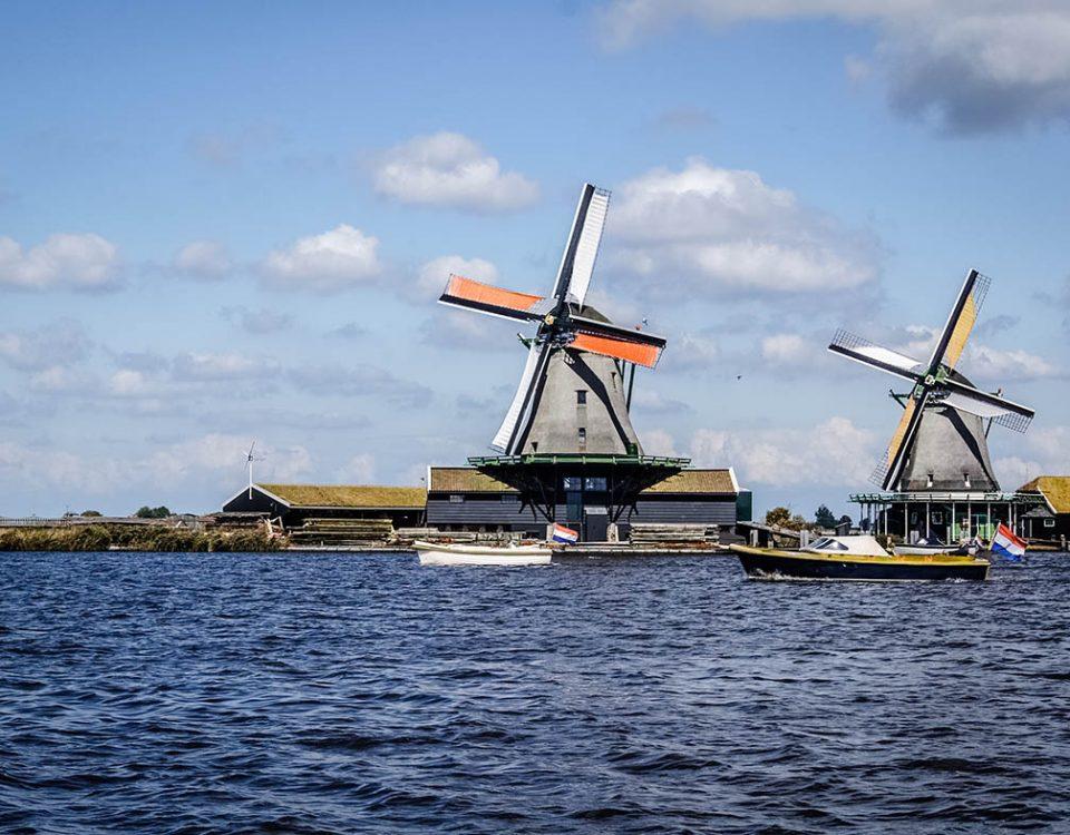 alternative energy blue sky wind mills boats